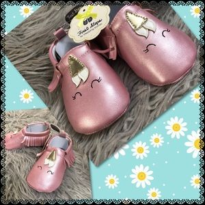 Pink unicorn infant moccasins with fringes